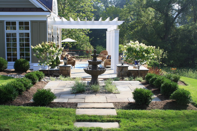 Fountain courtyard and plantings traditional landscape for Landscaping a courtyard pictures