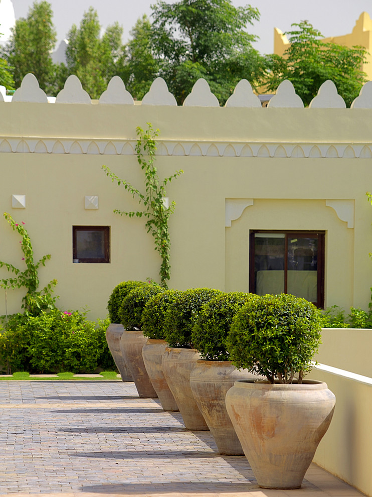 Design ideas for a mediterranean brick landscaping in Other.