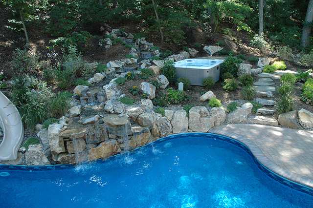 Freeform Pool With Waterfall traditional-landscape