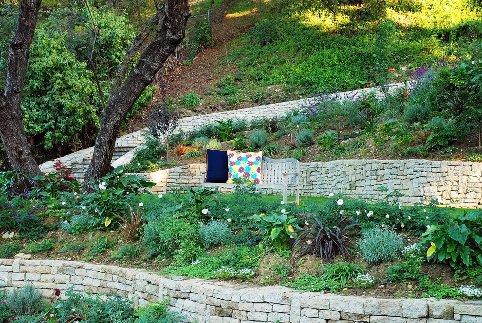 Photo of a french country hillside landscaping in Los Angeles.