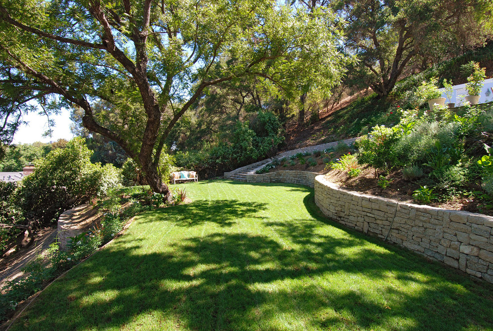 Photo of a french country backyard landscaping in Los Angeles.