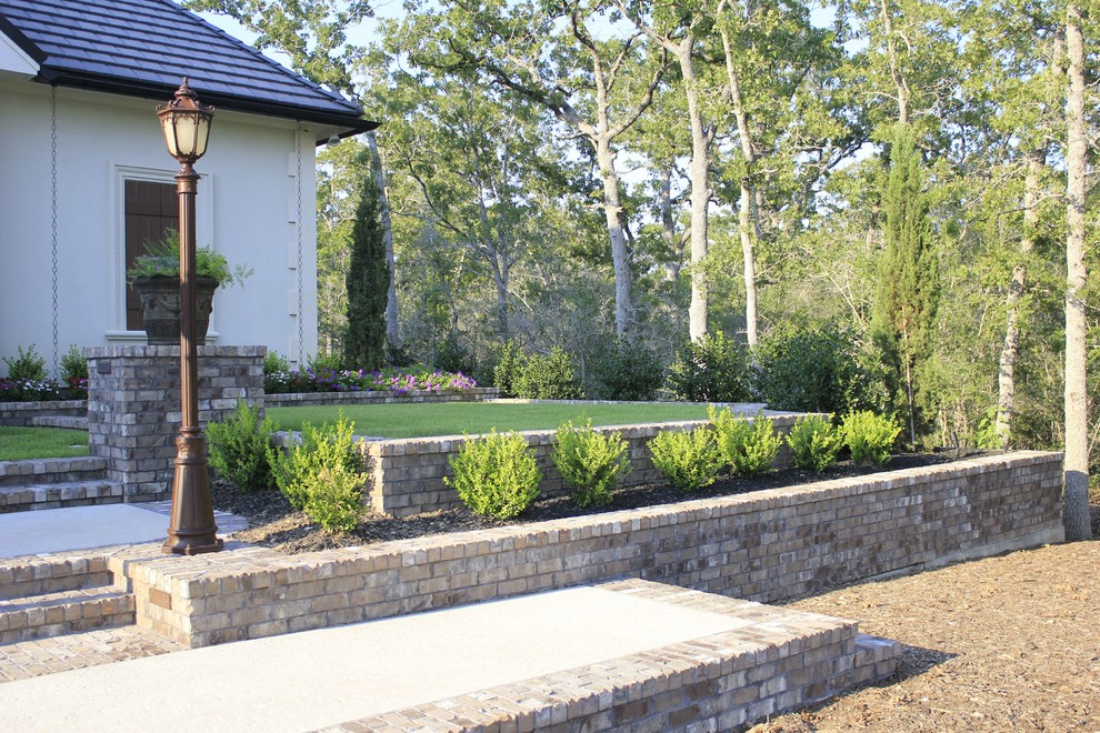 Inspiration for a mid-sized traditional partial sun front yard concrete paver landscaping in Dallas for spring.