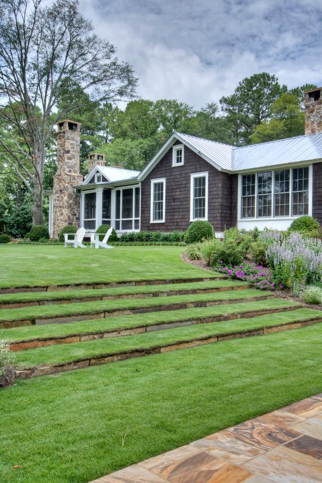 Inspiration for a farmhouse hillside landscaping in Atlanta.