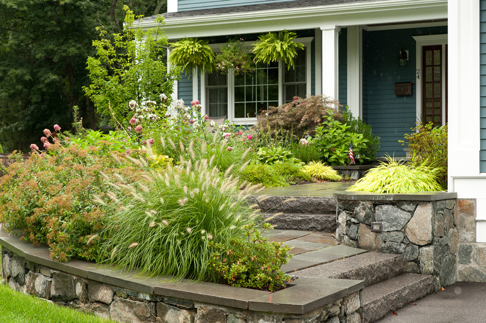 This is an example of a large traditional drought-tolerant and partial sun front yard stone landscaping in Boston.