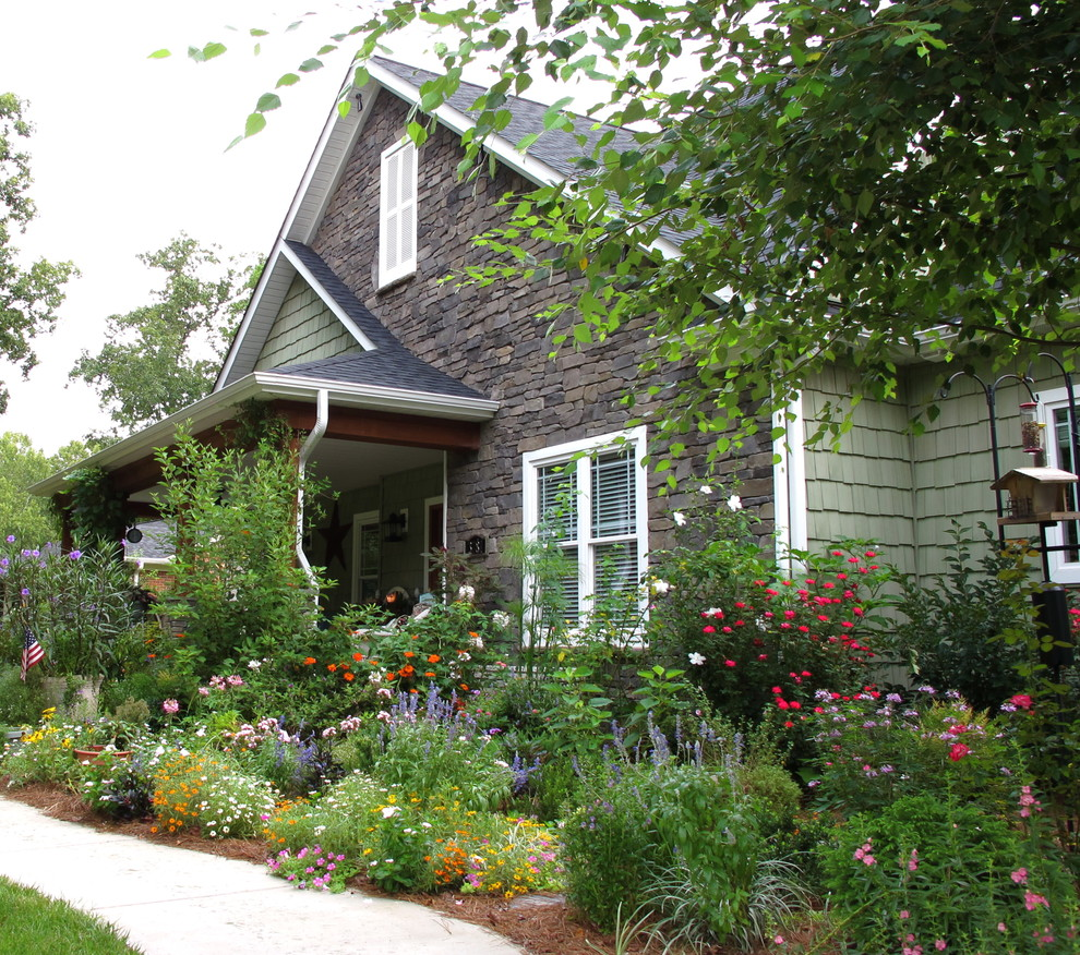 Photo of a traditional partial sun front yard flower bed in Charlotte.