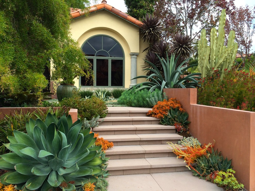 Photo of a mediterranean full sun front yard concrete paver landscaping in San Diego.