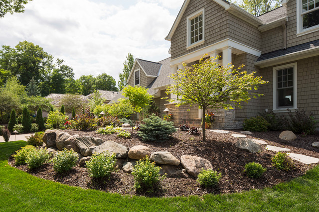 Front Yard With Boulder Wall And Shrub Bed Traditional