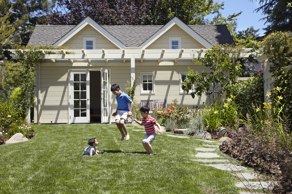Photo of a small traditional full sun backyard stone landscaping in San Francisco.