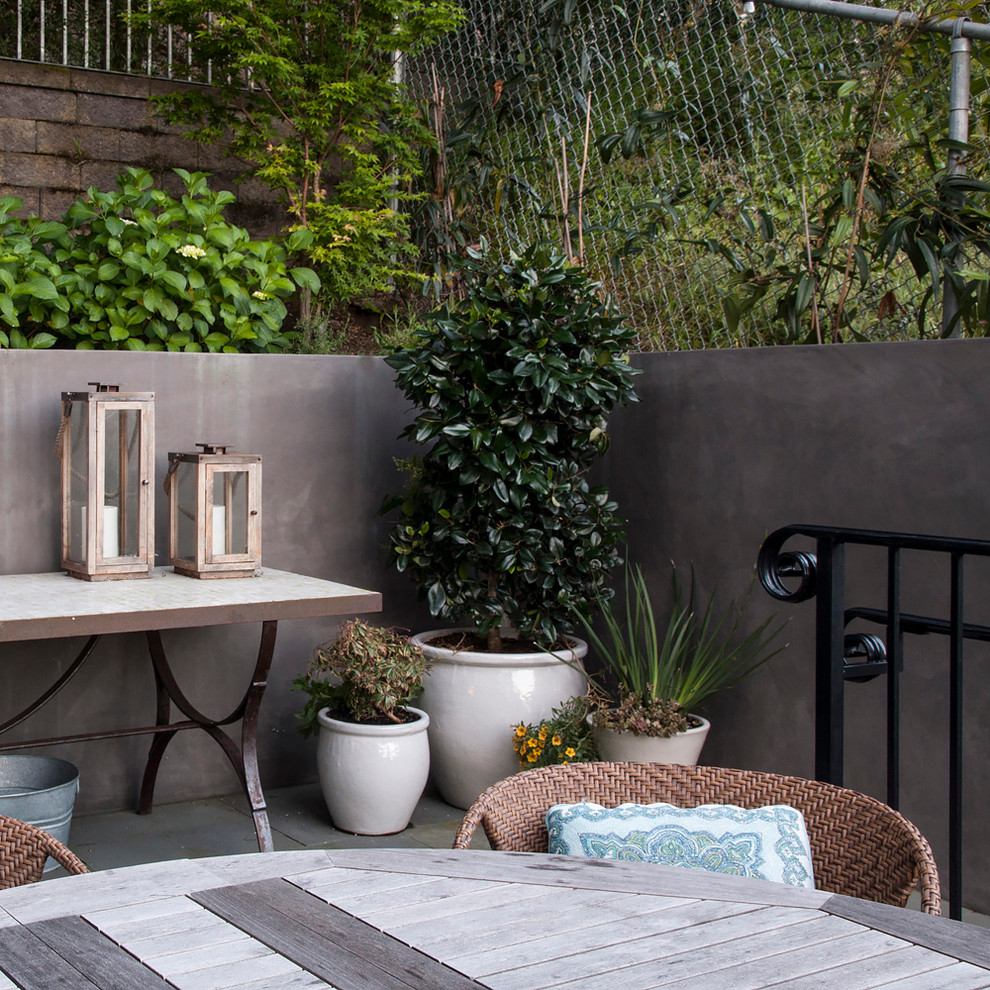 Design ideas for a large traditional full sun backyard concrete paver landscaping in San Francisco.
