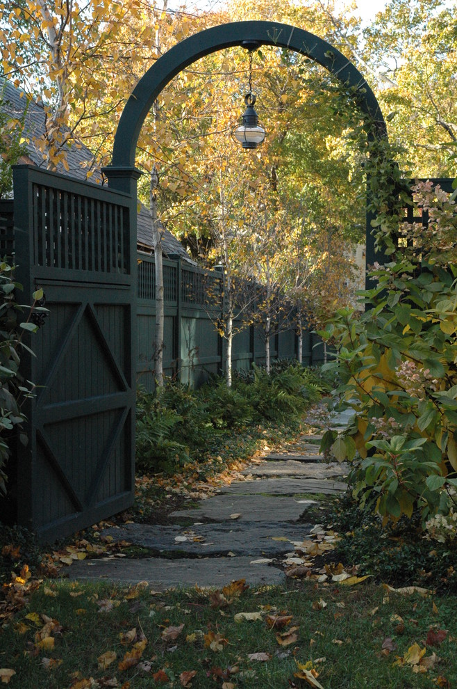 This is an example of a traditional vinyl fence landscaping in Boston.
