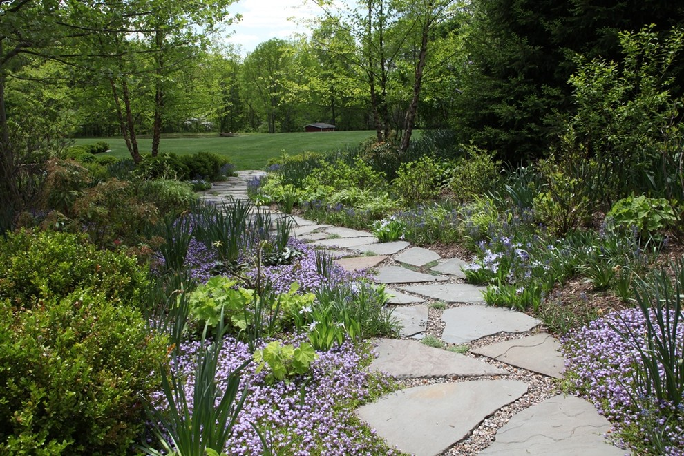 Inspiration for a large traditional backyard stone formal garden in Newark.