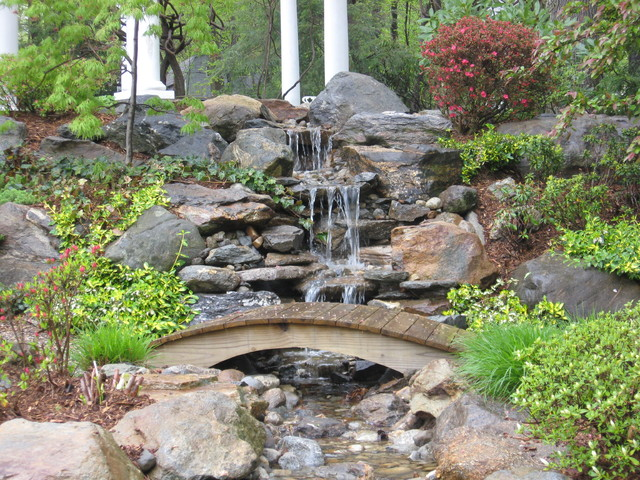 garden pond and waterfall with bridge in connecticut - traditional - garden - miami