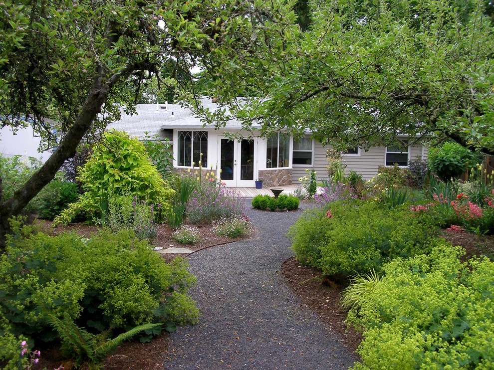 Inspiration for a traditional backyard landscaping in Portland.