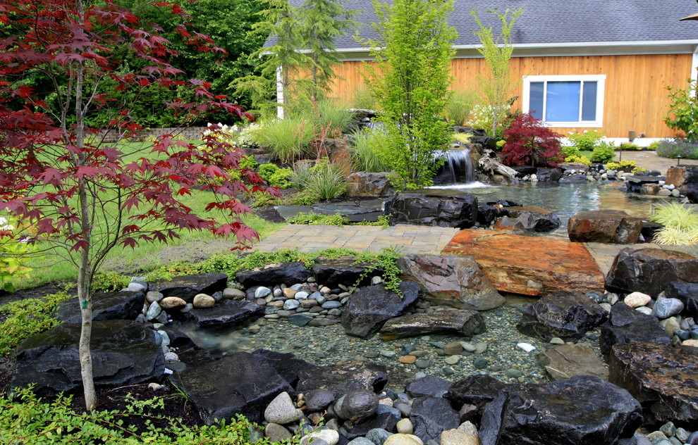 Design ideas for a traditional water fountain landscape in Seattle.