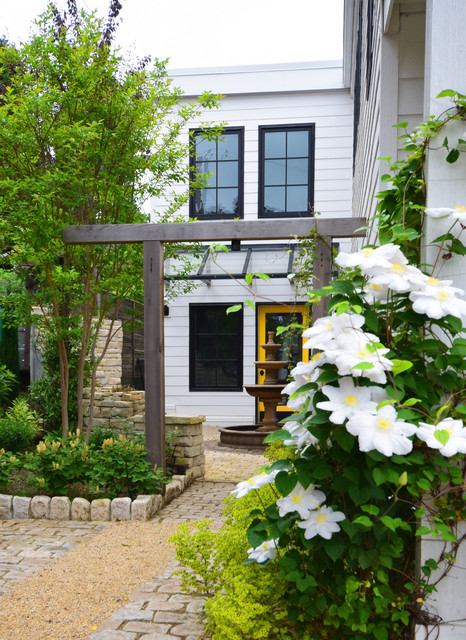 Inspiration for a mid-sized traditional partial sun backyard stone landscaping in Seattle.
