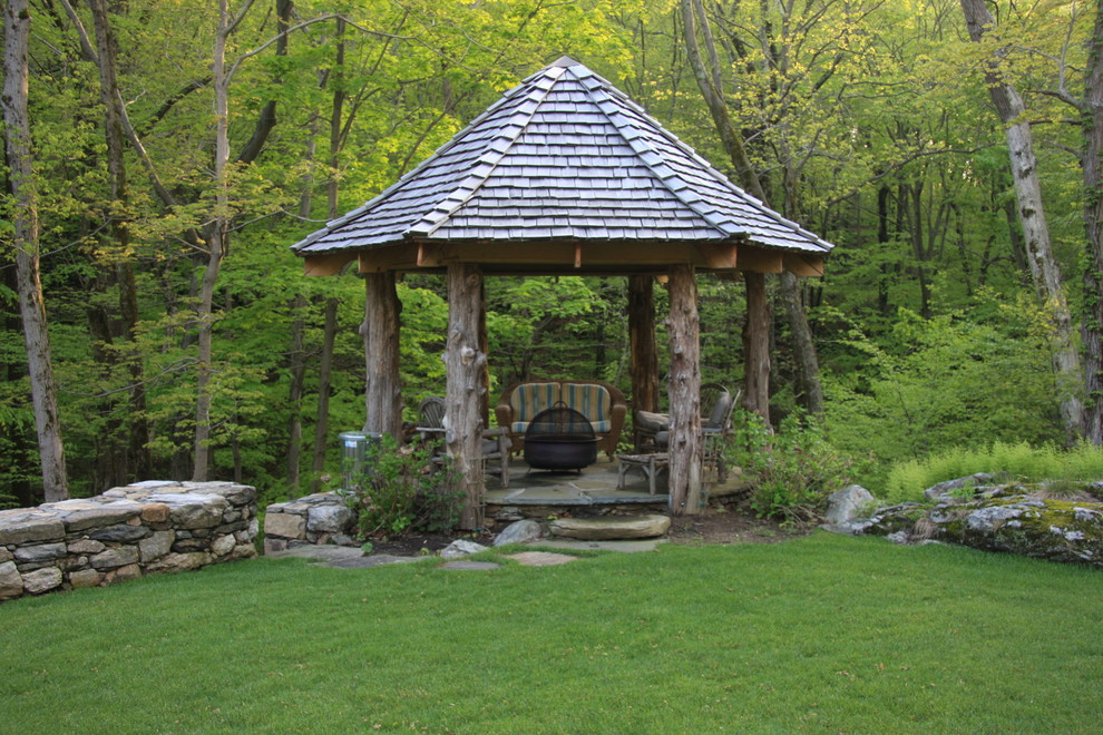Photo of a rustic landscaping in New York with a fire pit.