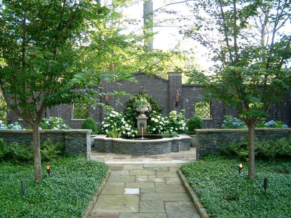 Inspiration for a large traditional backyard formal garden in Atlanta.