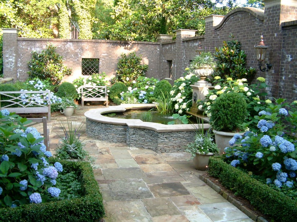 Photo of a traditional backyard stone formal garden in Atlanta.