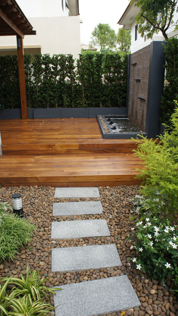Gold teak deck with modern water wall feature tropical for Thai garden design pictures