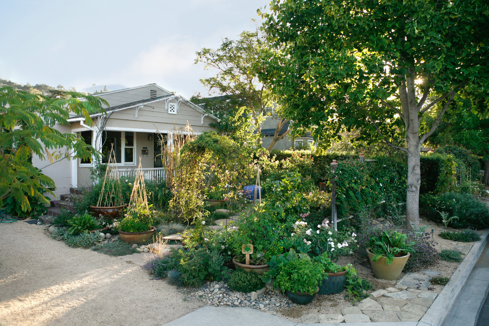 Photo of a mid-sized traditional partial sun front yard landscaping in Santa Barbara.