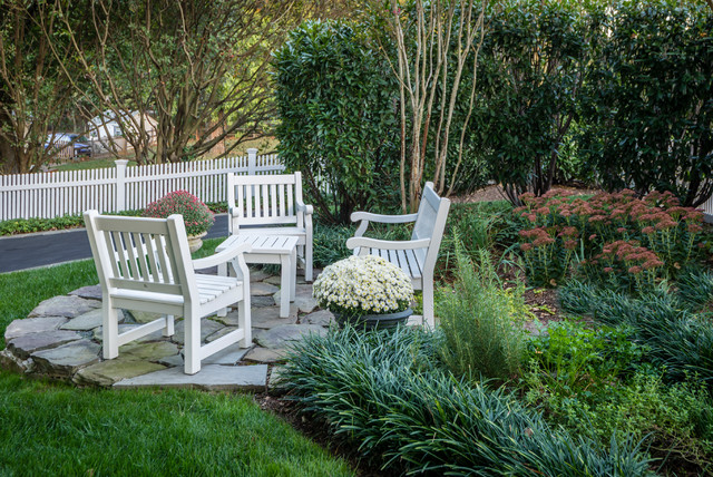 Design ideas for a small contemporary full sun side yard stone landscaping in DC Metro for summer.