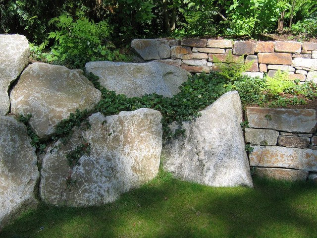 Granite boulders meet stone walls Beach Style Garden Seattle