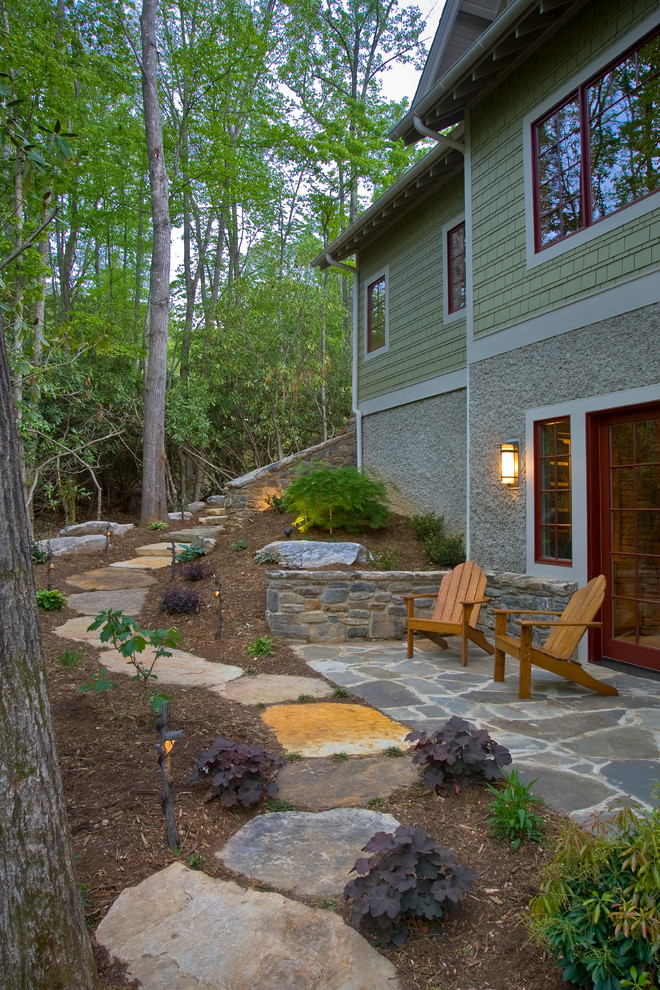 Design ideas for a mid-sized eclectic backyard stone landscaping in Other.