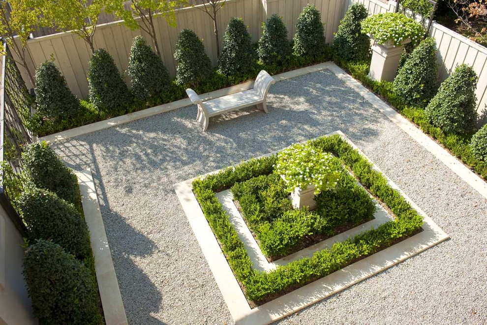 Photo of a small traditional gravel formal garden in Dallas.