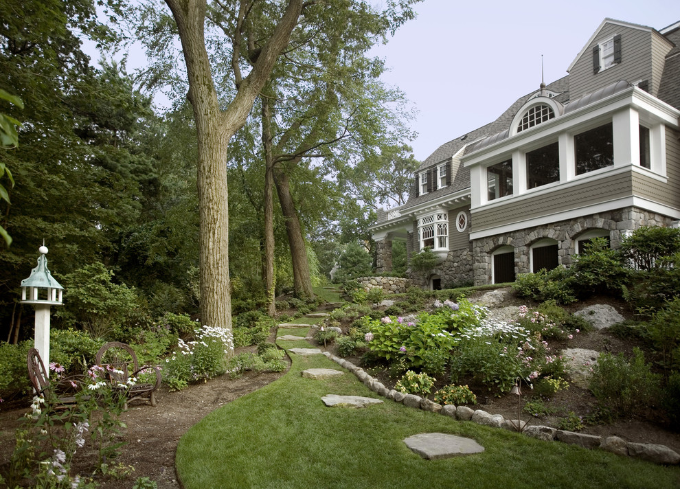 This is an example of a huge traditional partial sun hillside stone landscaping in Boston.