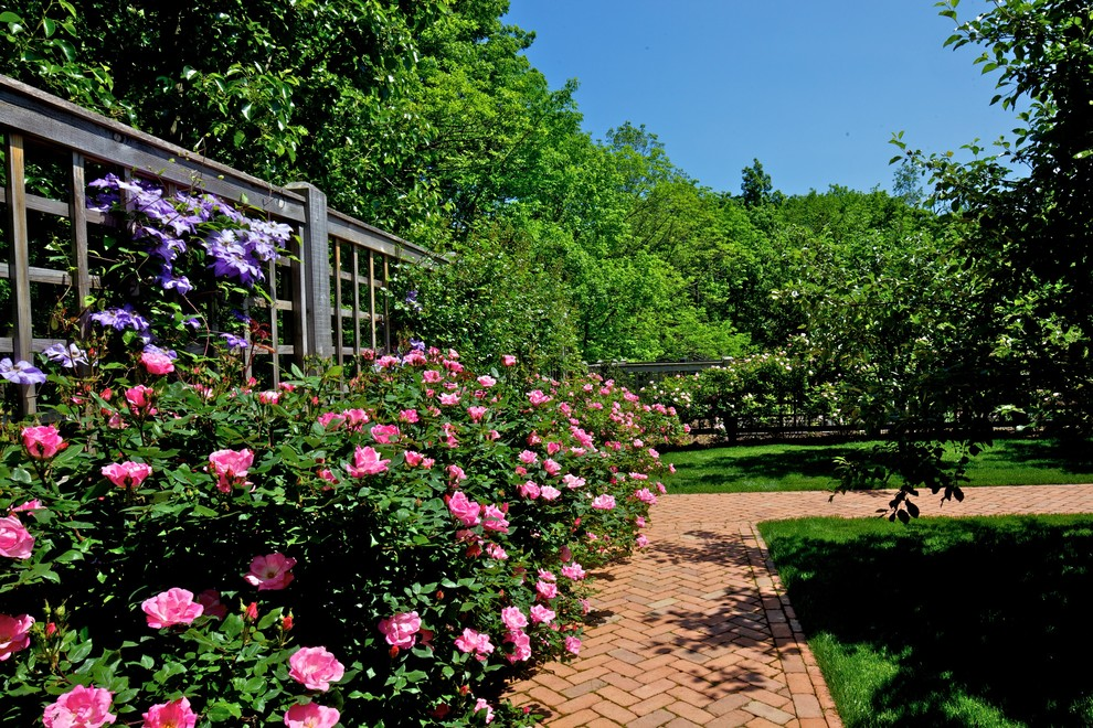 Inspiration for a large traditional full sun backyard brick landscaping in New York for summer.