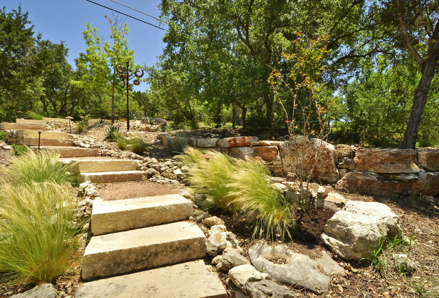 Design Ideas For A Large Rustic Hillside Brick Retaining Wall Landscape In Austin