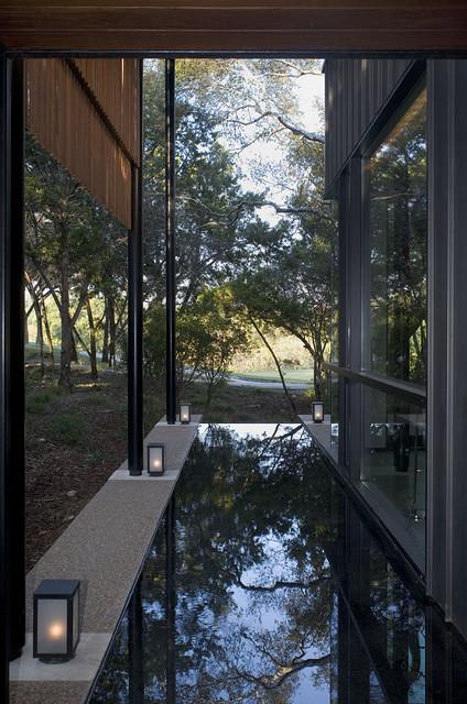 Design ideas for a contemporary water fountain landscape in Austin.