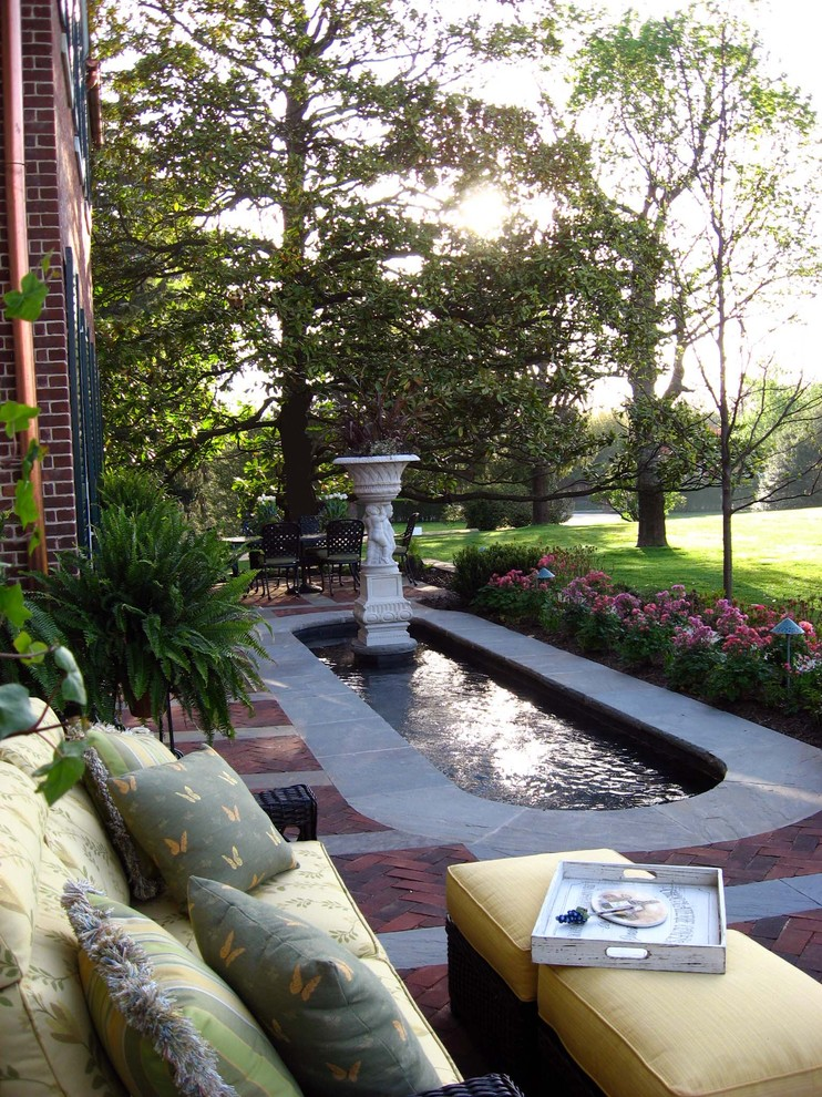Photo of a small traditional brick water fountain landscape in New York.