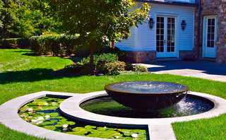 Small round water fountain and small pond in one design.