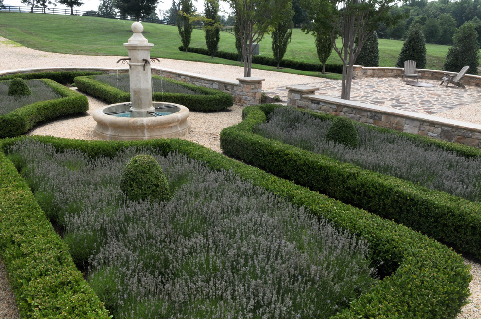 This is an example of a mediterranean stone formal garden in DC Metro.