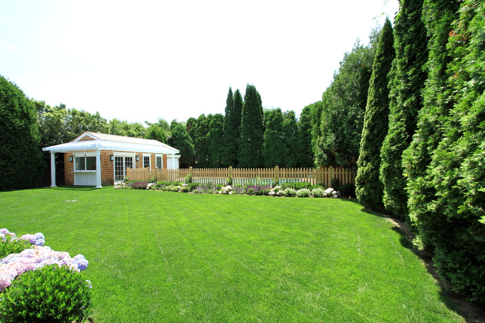 Photo of a large traditional backyard landscaping in New York.