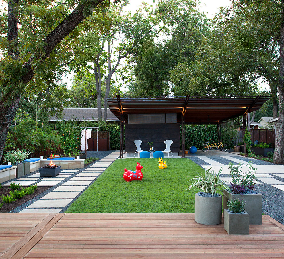 This is an example of a contemporary partial sun concrete paver landscaping in Austin with a fire pit.