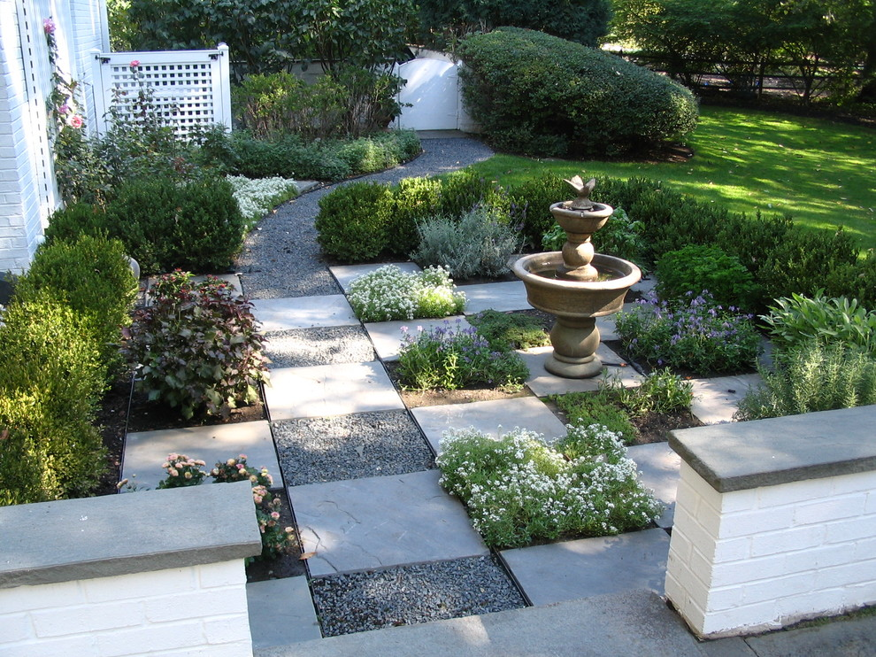 This is an example of a traditional partial sun side yard gravel water fountain landscape in Chicago for summer.