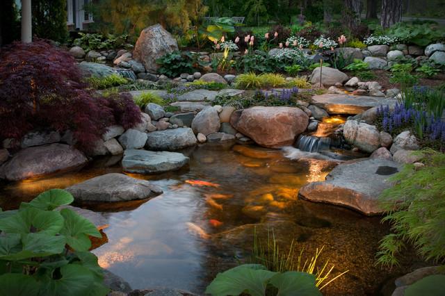 Intimate courtyard pond and stream modern garden for Modern pond waterfall