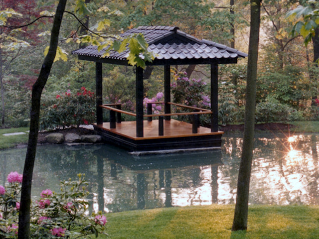 Intimate waterfront deck inspired by japanese pagoda for Japanese decking garden