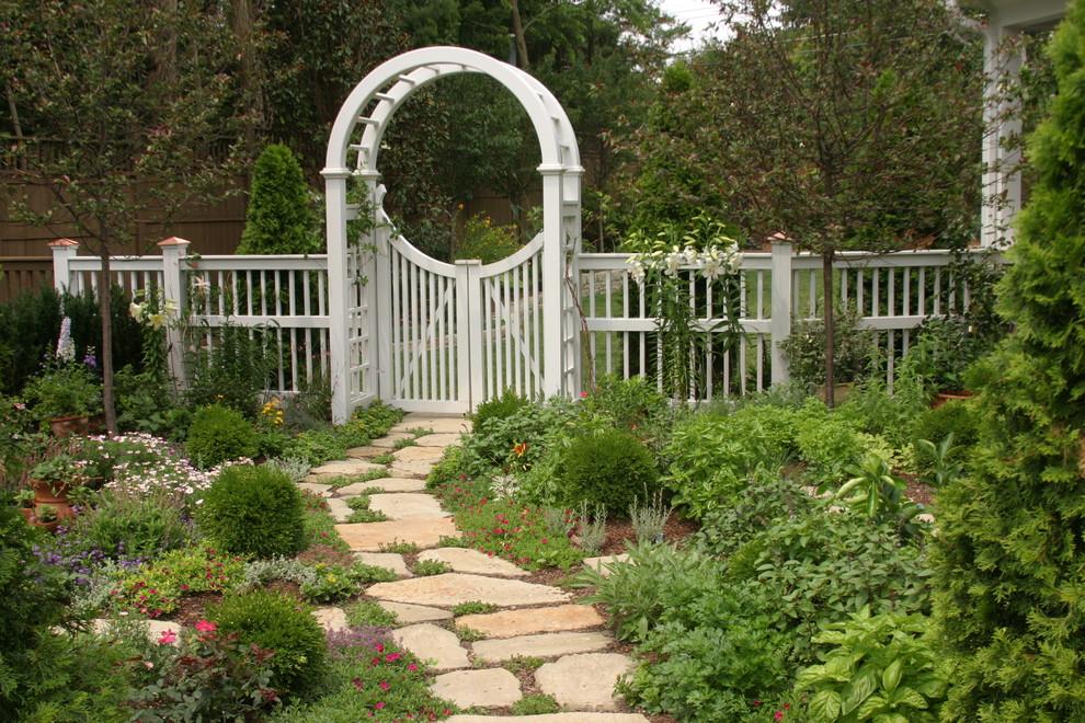 Photo of a large traditional full sun backyard stone garden path in Orange County.