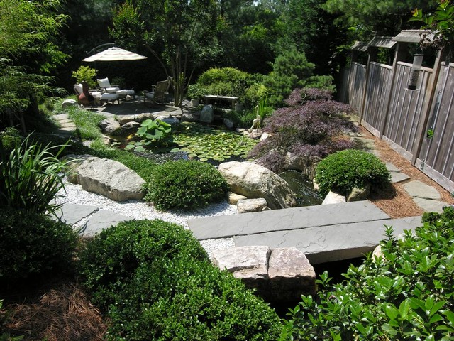 Japanese inspired garden with koi pond asian landscape for Japanese koi pond garden