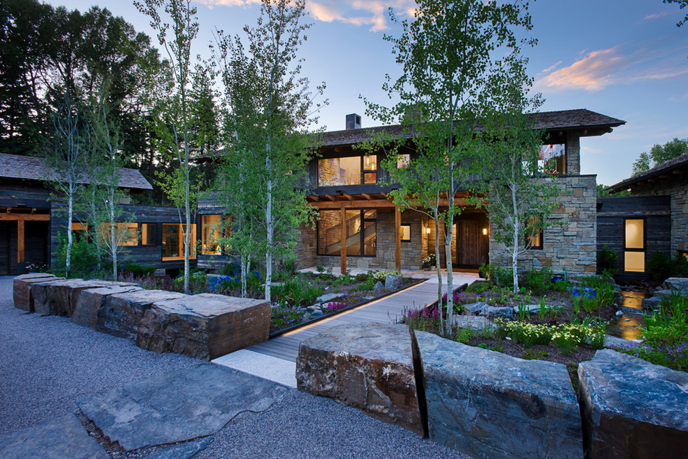 Inspiration for a rustic front yard landscaping in Salt Lake City with decking.