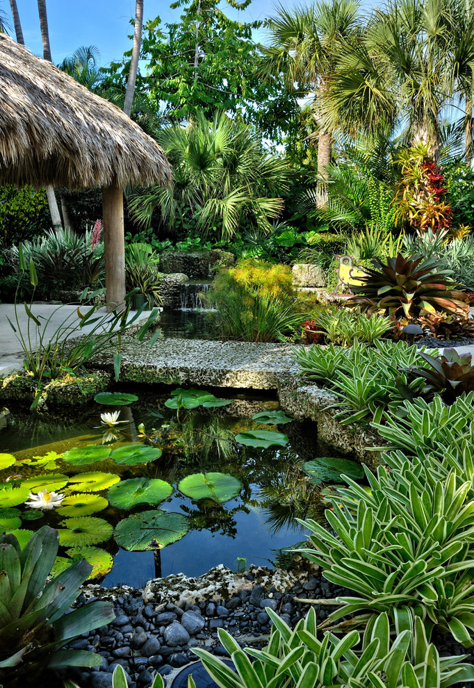 This is an example of a tropical partial sun water fountain landscape in Miami.