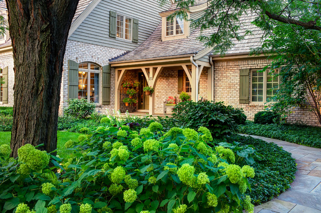 Photo of a traditional shade front yard stone landscaping in Chicago.