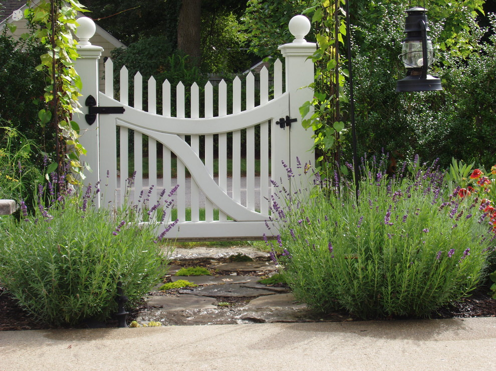 Inspiration for a traditional front yard stone landscaping in Boston.