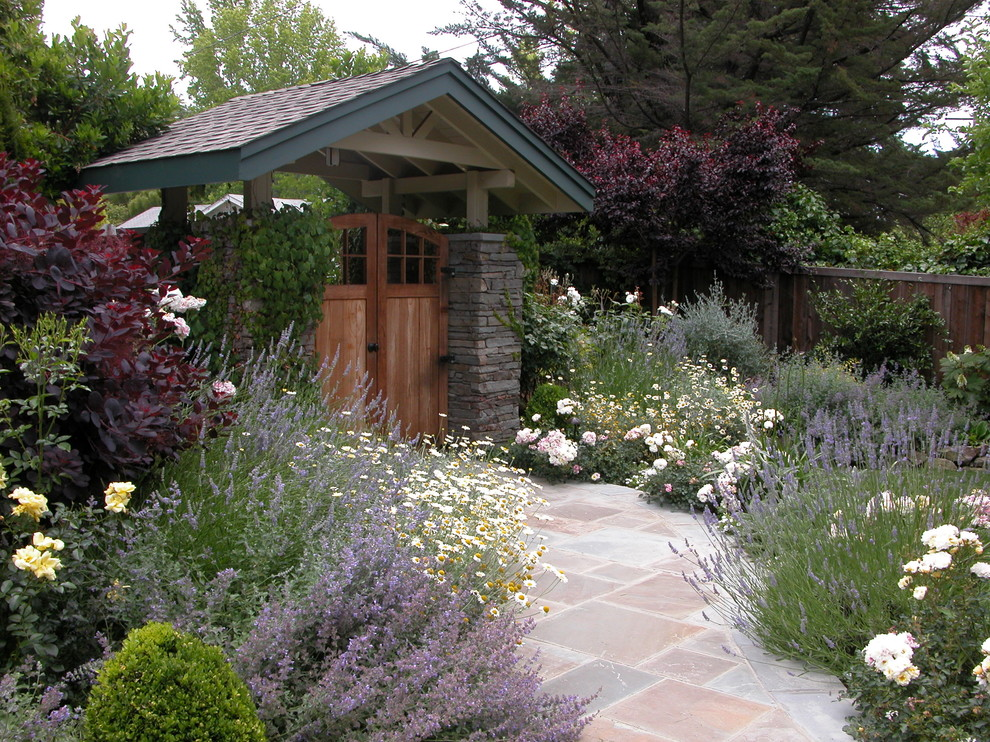 Inspiration for a mid-sized contemporary partial sun front yard stone flower bed in San Francisco for summer.