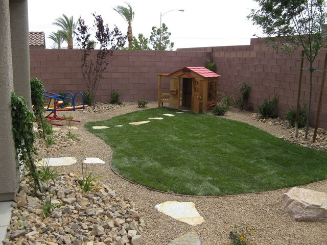 Mulch Backyard Dogs : Kid Friendly Backyard  Tropical  las vegas  by Taylormade