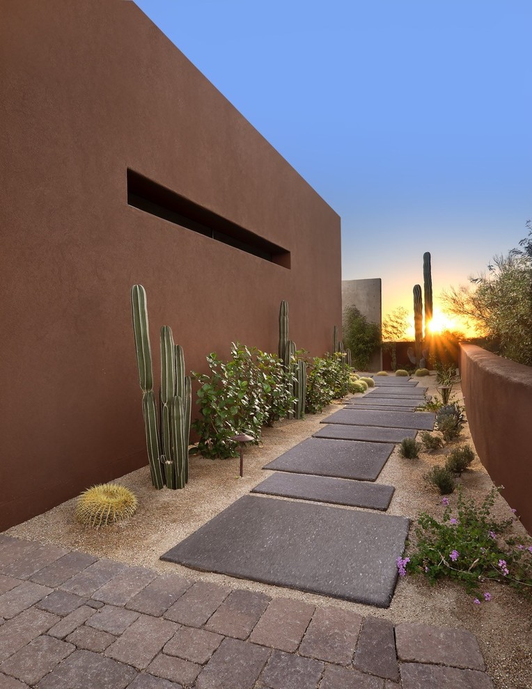 Design ideas for a large southwestern drought-tolerant and full sun side yard concrete paver garden path in Phoenix for fall.