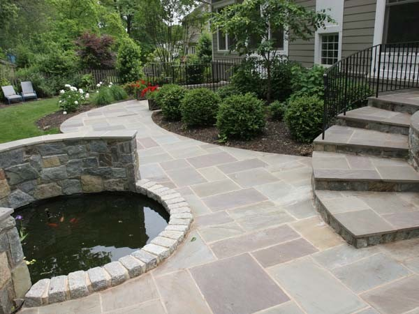 Koi pond and flagstone patio modern landscape other for Modern koi pond design photos